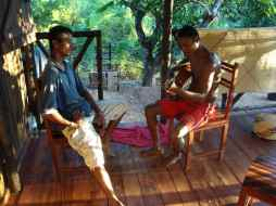 My language helper, nicolae (left), and another friend relaxing on the front porch (thanks for the guitar, Leachmans!)