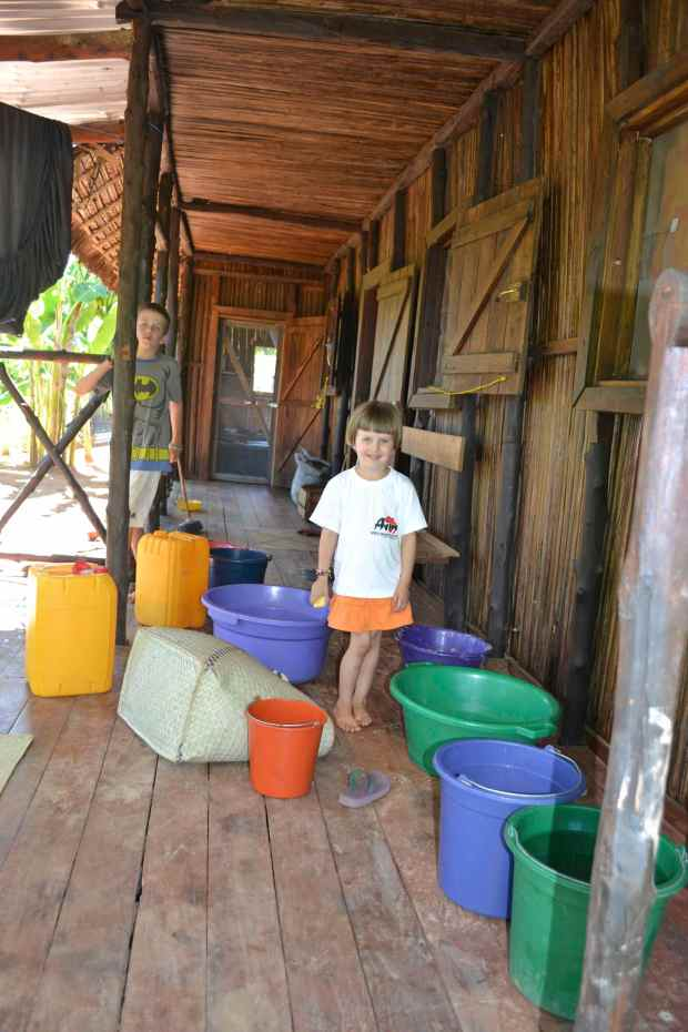 The kids organizing our buckets... No running water = importance of buckets!
