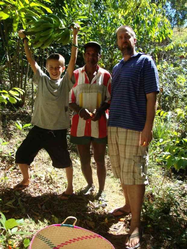 Our neighbor, Papa Sabutu, giving us a tour of his jungle farm. He loaded us up with coffee, bananas, mandarins, oranges, cassava, and black pepper!