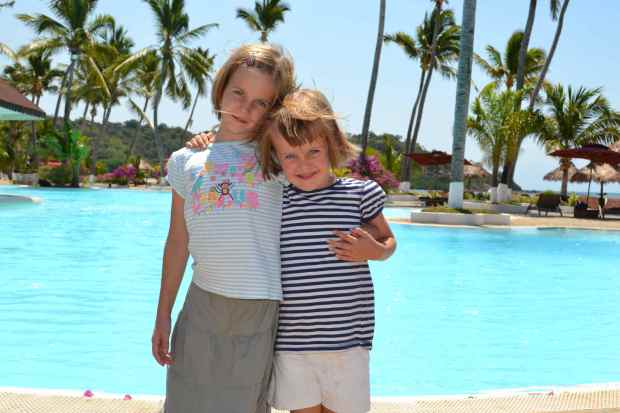 Sisters enjoying the pool